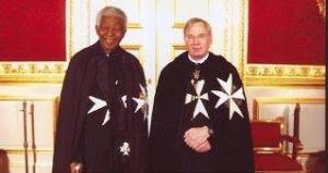 Fait Grand Chevalier de l'Ordre de Malte...la photo est éloquente.
