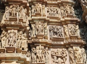 5671544-famous-kamasutra-scenes-on-the-wall-of-hindu-temple-in-khajuraho-india