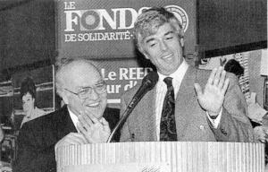 Claude Blanchet ,c'est lui devant le micro.En 1991, Pauline est députée péquiste de Taillon à l'Assemblée nationale pendant que son mari, Claude Blanchet est lui, à la tête du Fonds de Solidarité (FTQ). Le FSFTQ a été créé par le PQ grâce au prêt de 10 millions obtenu par la ministre du travail d'alors, Pauline Marois. Pour ne pas éveiller de soupçons, Claude Blanchet envoie à sa place, son associé fédéraliste Henry Walch faire changer le zonage des terrains de l'île Bizard afin d'en faire exploser la valeur marchande.