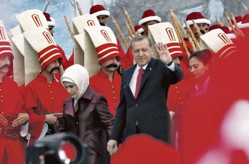 Turkish President Tayyip Erdogan, accompanied by his wife Emine Erdogan (L), greets his supporters as he arrives at the a ceremony to mark the 562nd anniversary of the conquest of the city by the Ottoman Turks, in Istanbul, Turkey, May 30, 2015. REUTERS/Murad Sezer